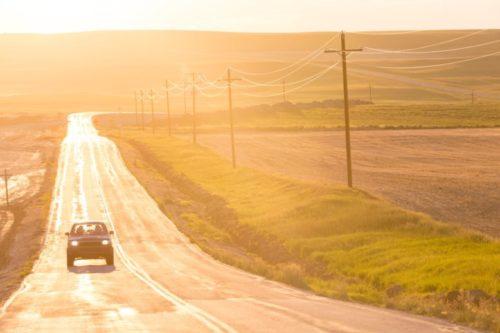 Open road at sunset, Montana, USA